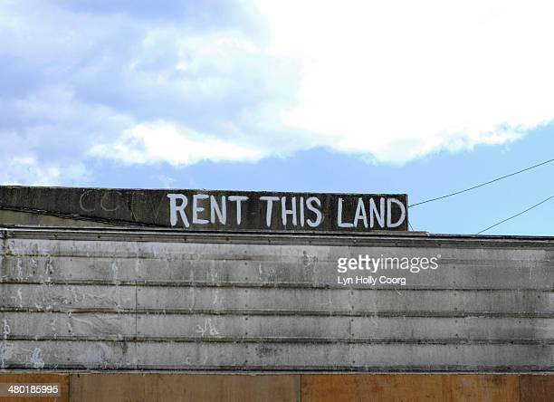 'rent this land' sign against blue sky - lyn holly coorg stock photos and pictures