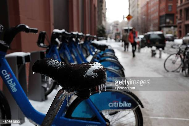 Rental bicycles with frozen seats are parked on the streets on February 2 2015 in New York City Another winter storm has brought inclement weather to...