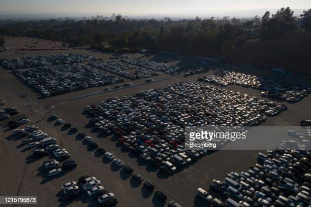Rental cars are stored in a parking lot at Dodger Stadium in this aerial photograph taken over Los Angeles, California, U.S., on Wednesday, May 27,...