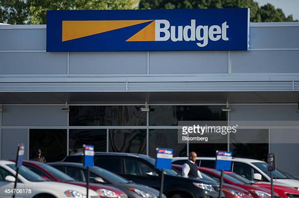 Rental cars sit parked outside of the Avis Budget Group Inc location for LaGuardia Airport in the Queens borough of New York US on Monday Aug 25 2014...