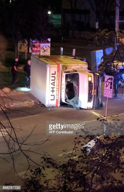 A rental truck lies on its side in Edmonton Canada on October 1 after a high speed chase Canadian police arrested a man early Sunday suspected of...