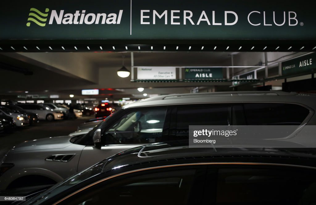 Rental Vehicles Sit Parked At A National Car Rental System Inc