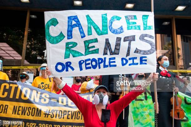 Renters and housing advocates attend a protest to cancel rent and avoid evictions in front of the court house amid Coronavirus pandemic on August 21...