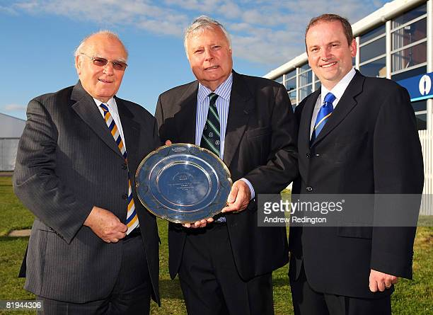 Renton Laidlaw, President of the AGW, and Roddy Williams, European Tour Press Officer present Peter Alliss the Michael Williams Outstanding Services...