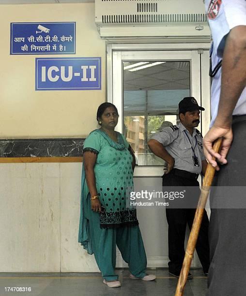 Renu aunt of Karan Pandey at the RML ICU Hospital on July 28 2013 in New Delhi India Karan Pandey a stunt biker a resident of Malviya Nagar was shot...