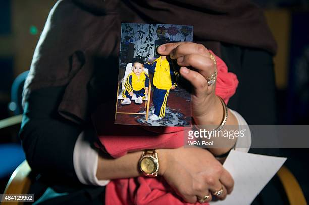Renu Begum eldest sister of Shamima Begum holds her sister's photo as she is interviewed by the media at New Scotland Yard as the relatives of three...