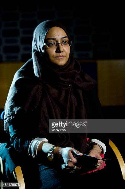 Renu eldest sister of Shamima Begum holds her sister's pajamas and photos while being interviewed by the media at New Scotland Yard as the relatives...