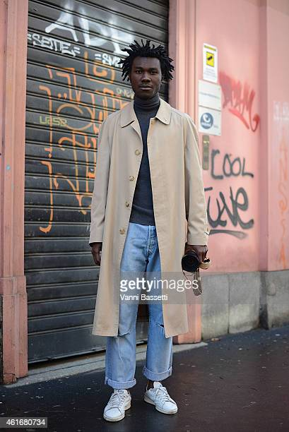 Renwe Jules poses wearing a vintage coat and Adidas shoes on January 17 2015 in Milan Italy