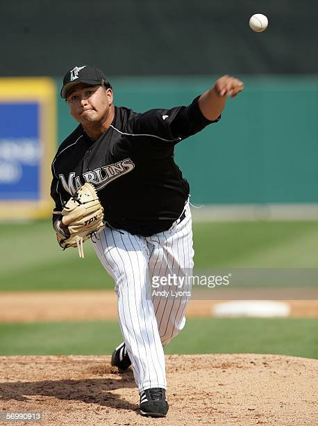 Renyel Pinto of the Florida Marlins throws a pitch during the Major League Baseball spring training game against the Baltimore Orioles on March 3...