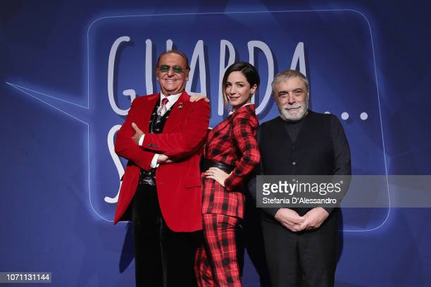 Renzo Arbore Andrea Delogu and Nino Frassica attend Guarda Stupisci TV Show Photocall In Milan on December 10 2018 in Milan Italy
