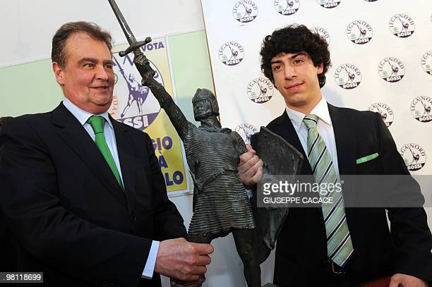 Renzo Bossi son of Umberto Bossi populist Northern League leader and Italian Minister Roberto Calderoli pose with the symbol of their party an...