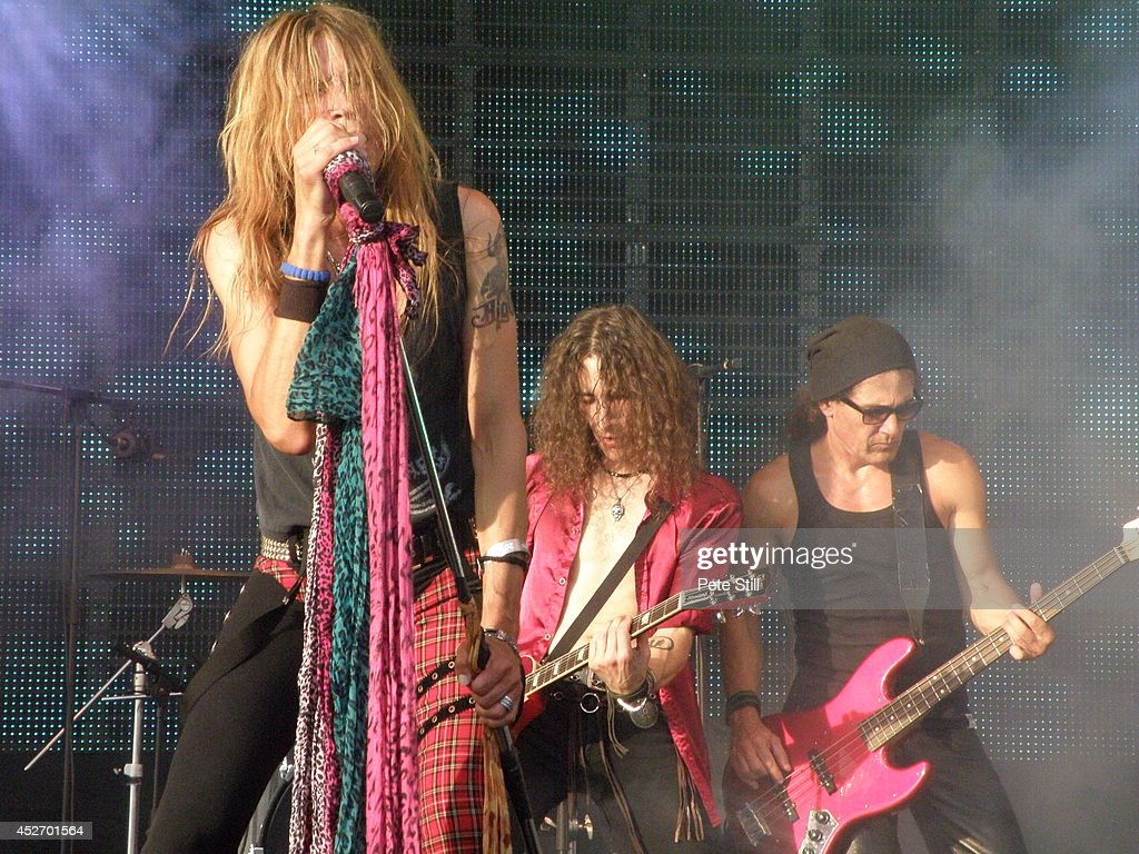 Renzo D'Aprano, Davide Pola and Massimo Conti of italian Aerosmith tribute band Big Ones perform on stage at Silverstone Classic at Silverstone on July 25, 2014 in Northampton, United Kingdom.