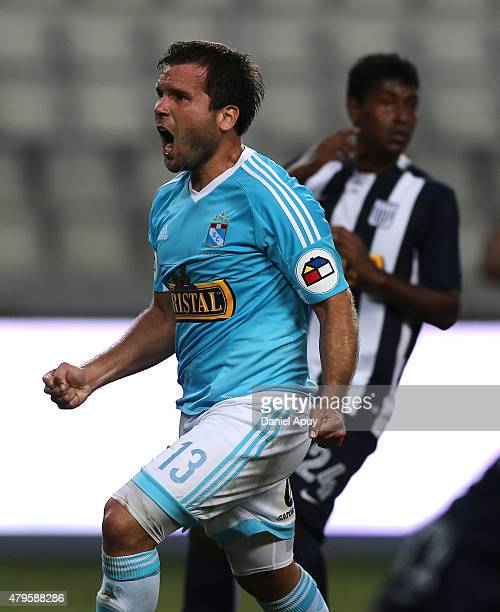 Renzo Reveredo of Sporting Cristal celebrates after scoring the first goal of his team during a match between Sporting Cristal and Alianza Lima as...