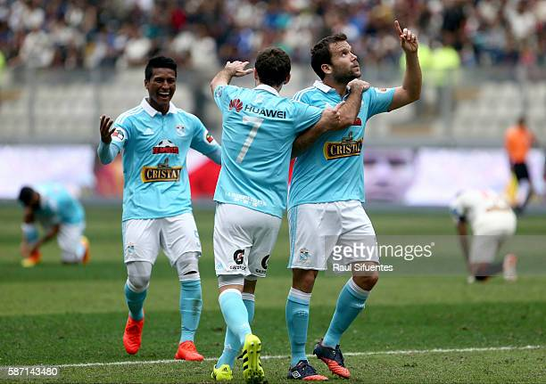 Renzo Revoredo of Sporting Cristal celebrates the first goal of his team against Universitario during a match between Universitario and Sporting...