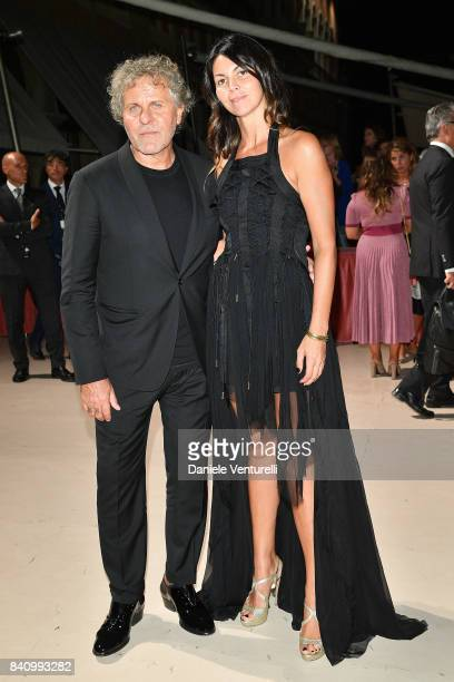 Renzo Rosso and Arianna Alessi arrive at the dinner after the Opening Ceremony during the 74th Venice Film Festival at Excelsior Hotel on August 30,...