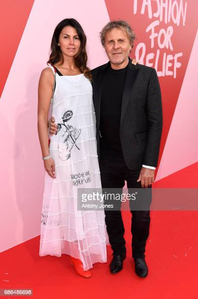 Renzo Rosso and Arianna Alessi attend the Fashion for Relief event during the 70th annual Cannes Film Festival at Aeroport Cannes Mandelieu on May 21...