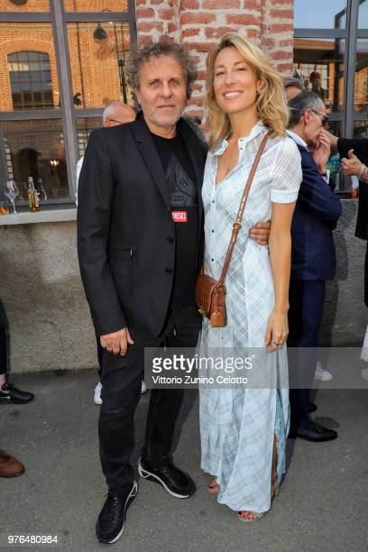 Renzo Rosso and Mia Ceran attend Diesel Red Tag by Glenn Martens on June 16 2018 in Milan Italy
