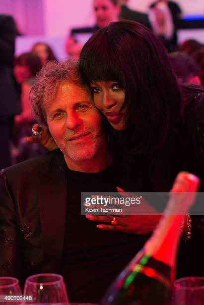 Renzo Rosso and Naomi Campbell are seen at amfAR Milano 2015 at La Permanente on September 26 2015 in Milan Italy