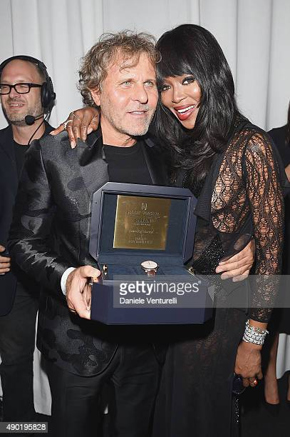 Renzo Rosso and Naomi Campbell attend the amfAR Milano 2015 after party at La Permanente on September 26 2015 in Milan Italy