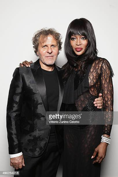 Renzo Rosso and Naomi Campbell pose at amfAR Milano 2015 at La Permanente on September 26 2015 in Milan Italy