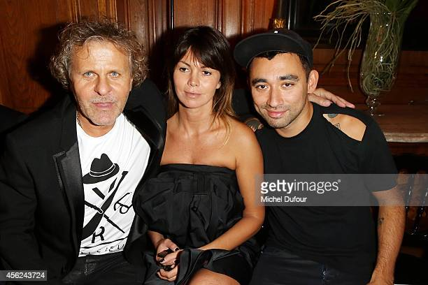 Renzo Rosso, Arianna Alessi and Nicola Formichetti attend the Viktor & Rolf show as part of the Paris Fashion Week Womenswear Spring/Summer 2015 on...