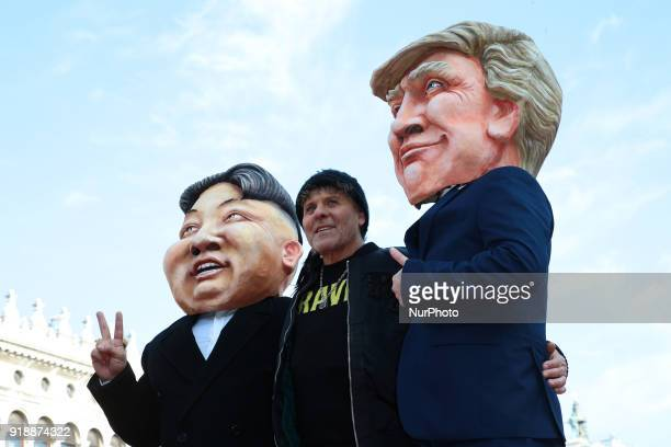 Renzo Rosso poses with a Donald Trump and a Kim Jong Un puppets at the event of the Eagle Flight on February 11 2018 in Venice Italy The theme for...