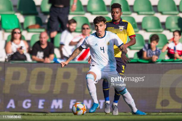 Renzo Saravia of Argentina and Diego Palacios of Ecuador battle for the ball during the UEFA Euro 2020 qualifier between Ecuador and Argentina on...