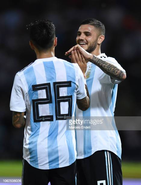 Renzo Saravia of Argentina celebrates with teammate Mauro Icardi after Isaác Brizuela of Mexico scores an own goal during a friendly match between...