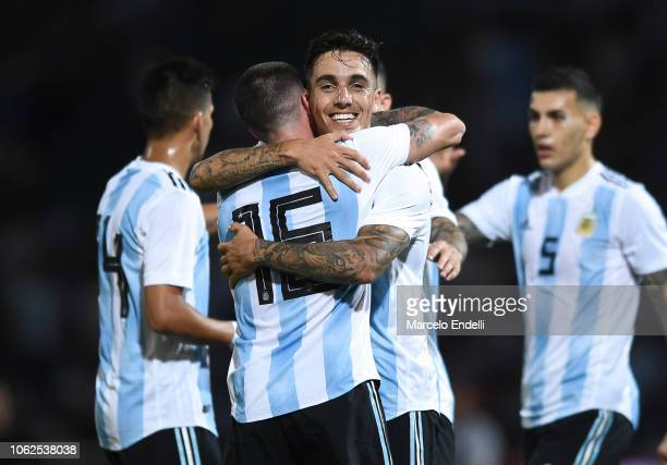 Renzo Saravia of Argentina celebrates with teammate Rodrigo De Paul after Isaác Brizuela of Mexico scores an own goal during a friendly match between...