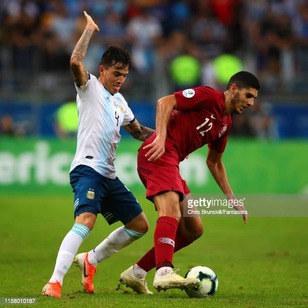 Renzo Saravia of Argentina in action with Karim Boudiaf of Qatar during the Copa America Brazil 2019 group B match between Qatar and Argentina at...