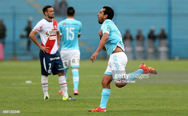 Renzo Sheput of Sporting Cristal celebrates after scoring the second goal of his team against Deportivo Municipal during a match between Sporting...