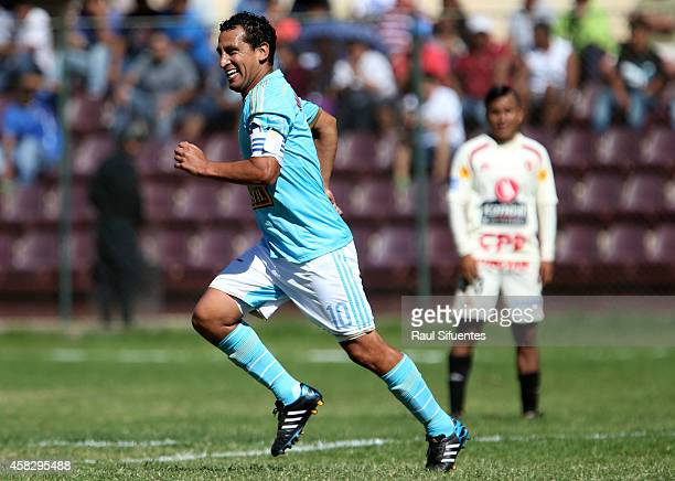 Renzo Sheput of Sporting Cristal celebrates after scoring the third goal of his team during a match between Leon de Huanuco and Sporting Cristal as...