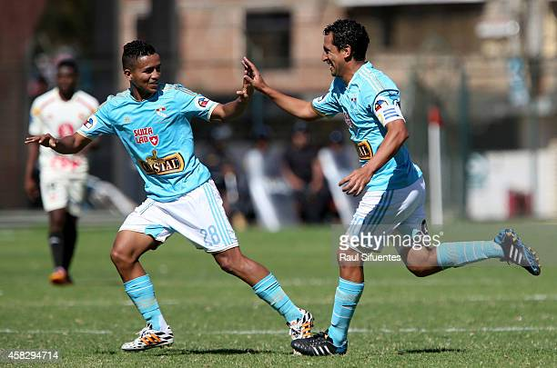 Renzo Sheput of Sporting Cristal celebrates with his teammate Edinson Chavez after scoring the third goal of his team during a match between Leon de...