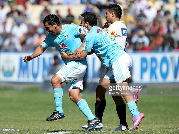 Renzo Sheput of Sporting Cristal celebrates with his teammates after scoring the third goal of his team during a match between Leon de Huanuco and...