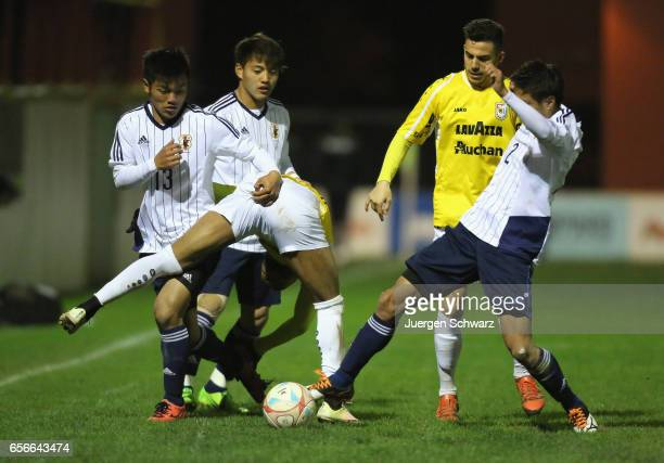 Reo Hatate of Japan and 30 Alexandre Lauriente of F91 fight for the ball beside So Fujitani of Japan and Edisson Jordanov during a friendly soccer...
