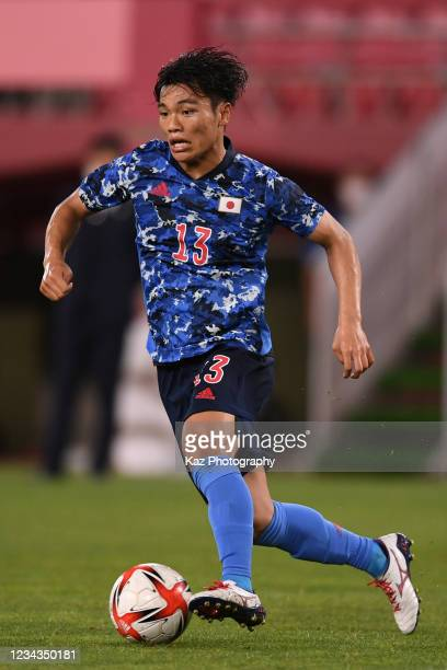 Reo Hatate of Japan dribbles the ball during the Men's Quarter Final match on day eight of the Tokyo 2020 Olympic Games at Kashima Stadium on July...