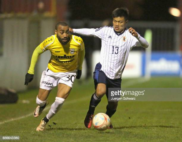 Reo Hatate of Japan tackles Alexandre Lauriente of F91 during a friendly soccer match between F91 Diddeleng and the Japan U20 team at Stade Jos...