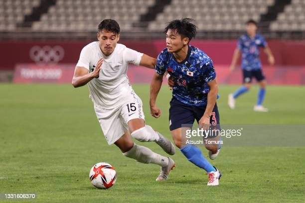 Reo Hatate of Team Japan battles for possession with Dane Ingham of Team New Zealand during the Men's Quarter Final match between Japan and New...