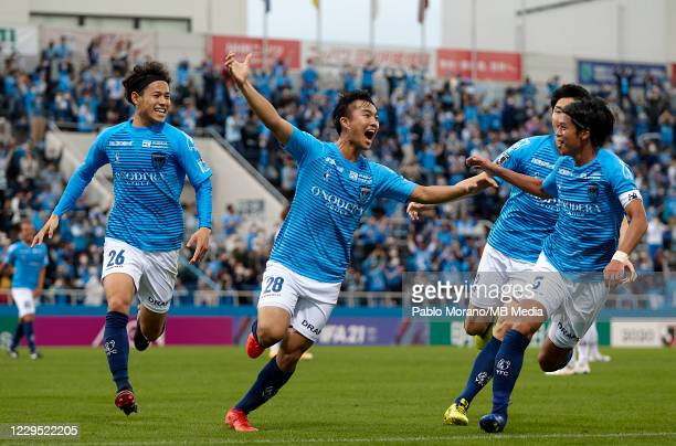 Reo Yasunaga of Yokohama celebrates with his teammates after scoring the second goal during the J.League Meiji Yasuda J1 match between Yokohama FC...