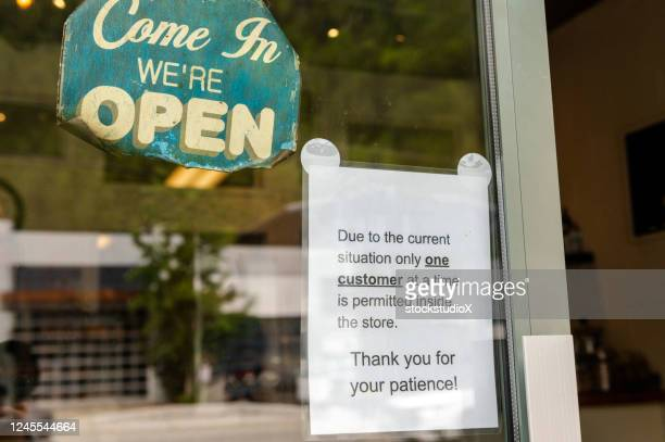 reopening signage at a bakery during covid-19 - reopening stock pictures, royalty-free photos & images
