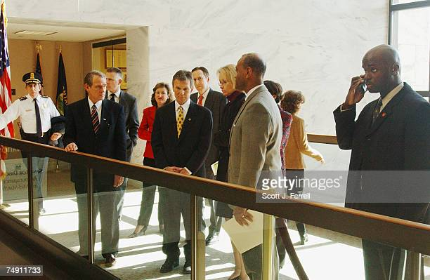 REOPENSSenate Majority Leader Tom Daschle DSD talks to Senate SergeantAtArms Alfonso Lenhardt Secretary of the Senate Jeri Thomson and other...