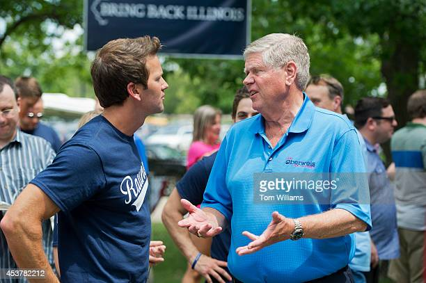 Rep Aaron Schock RIll left talks with Jim Oberwies Republican senate candidate for Illinois during Republican Day at the Illinois State Fair in...