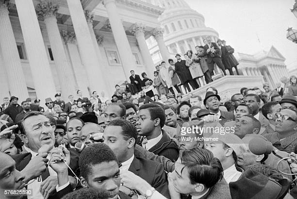 Rep Adam Clayton Powell speaks to a rally for him at the US Capitol Powell is on the left