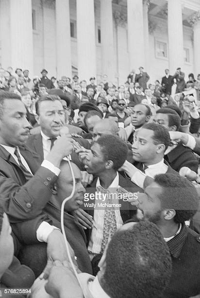 Rep Adam Clayton Powell speaks to a rally for him at the US Capitol Powell is the guy second from left
