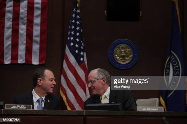 S Rep Adam Schiff listens to Rep Mike Conaway prior to a hearing before the House Intelligence Committee November 1 2017 on Capitol Hill in...