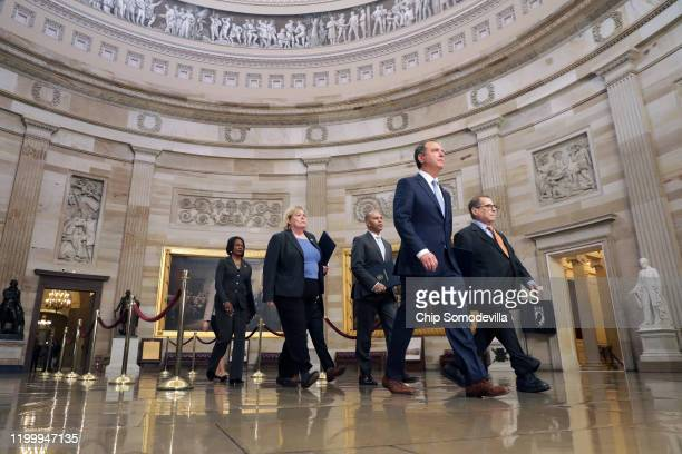 Rep Adam Schiff Rep Jerrold Nadler Rep Zoe Lofgren Rep Hakeem Jeffries Rep Val Demings Rep Jason Crow and Rep Sylvia Garcia walk through the Rotunda...