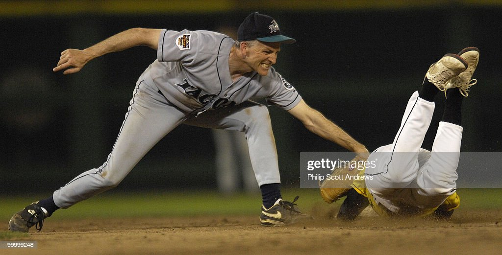 Rep. Adam Smith, D-Wa, tags out Louie Gohmert, R- Tx, while stealing to end the top of the 7th inning.