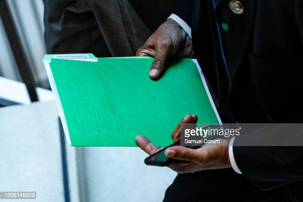 Rep Al Green holds a folder labeled Talking Points and Summary on Coronavirus as he leaves a closeddoor briefing from Vice President Mike Pence and...