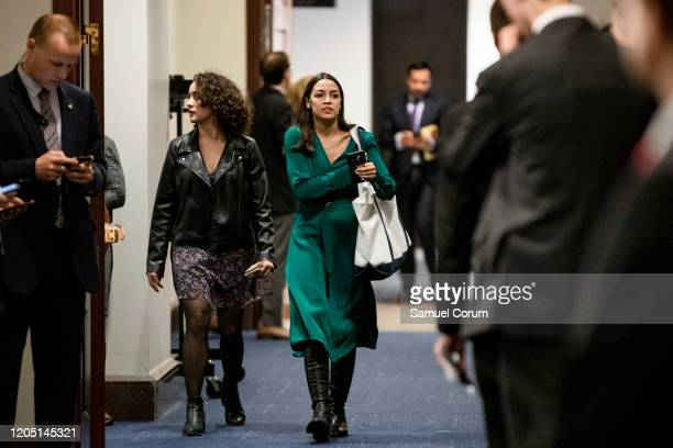 Rep Alexandria Ocasio Cortez heads to a closeddoor briefing from Vice President Mike Pence and Anthony Fauci Director of the National Institute of...