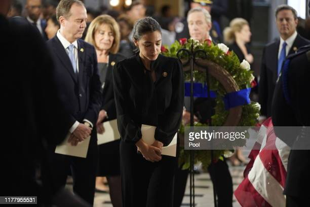 Rep. Alexandria Ocasio-Cortez and House Intelligence Committee Chairman Rep. Adam Schiff visit the flag-draped casket of Rep. Elijah Cummings after a...